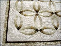 This is not a crazy quilt, but when I came across this picture, I felt inspired -- this might be the most beautiful double wedding ring quilt I've ever seen!