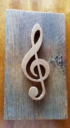 Scrollsaw treble clef mounted on barnwood made a pretty good sign! I believe I cut the treble clef from maple.