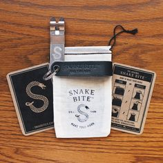 Original Snake Bite - Black Leather key chain bottle opener with gift packaging. Perfect for any beer lover!