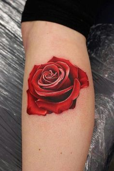 Beautiful rose tattoo..so vibrant and love how its not outlined with black