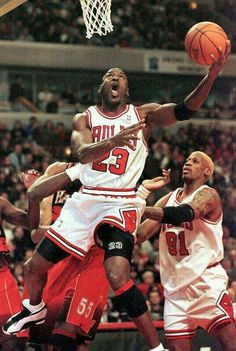 The GOAT flips in a reverse layup against the Hawks in Chicago.