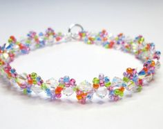 Ruby and silver crystal swarovski bracelet ruby by BuzzybeeBeading
