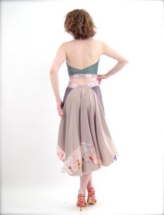 The signature poema silhouette, fashioned from soft, shimmery knit and a tail of gorgeous crepe silk. The tail is inlaid with translucent