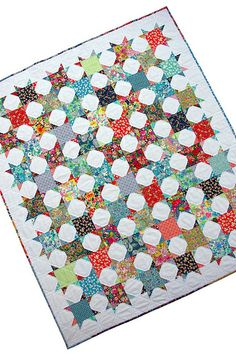 Bloomsbury Gardens ~ A Finished Quilt I love that this is just a charm square alternating with a snowball block - but impact!