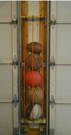 Sports Ball Holder Need to organize your garage? This DIY sports ball holder uses space between the garage doors to organize your space.Need to organize your garage? This DIY sports ball holder uses space between the garage doors to organize your space. Garage Organization Systems, Garage Storage Solutions, Diy Garage Storage, Storage Ideas, Organization Ideas, Garage Systems, Shelf Ideas, Vehicle Storage, Garage Door Opener