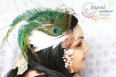 Headpiece with gorgeous wire wrapping, feathers and couture pieces. Mixed media crowning at its best!