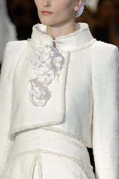Chanel is composed of only a few elements: white camellias, quilted bags, Austrian doorman's jackets, pearls, chains, shoes with black toes. Description from 30somethingurbangirl.com. I searched for this on bing.com/images
