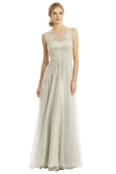 Ethereal beauty is yours in this gown by Catherine Deane. Layers of tulle with embroidered detail will make you feel classic and elegant. Simply pair with Badgley Mischka Jewelry's Ocean Moon Earrings for the perfect finishing statement.