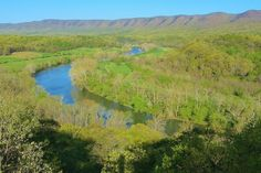 The South Fork of the Shenandoah River winds through the Shenandoah Valley past the towns of Front Royal and Luray.