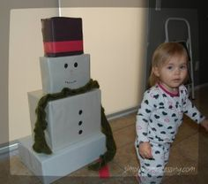 Make a snowman out of boxes for a toddler to build and dress over and over!