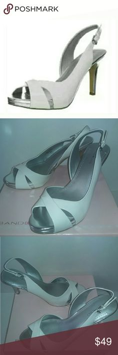 """Bandolino Sterling Dressy Sandals A dressy peep toe white high heel sandal with faux patent upper, adjustable buckle straps, and cushioned silver footbed. Approximate measurements: 3.75"""" heel and 0.75"""" platform. Bandolino Shoes Sandals"""