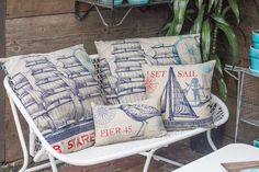 Nautical inspired accent pillows add cozy seaside appeal to your porch or family room. Anchors Aweigh!  http://rogersgardens.com/home-decor/