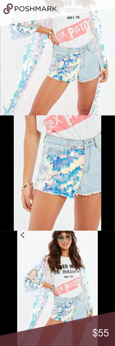 JUST IN MISSGUIDED Pink Sequin Panel Shorts Matching Missguided Pink Sequin Panel Shorts can be purchased with the matching Kimono or Separately. Features Gorgeous Pink Sequins on one side, high waist and trendy fringes. Blue Denim back side. Size is Med. UK Size 10 Equals USA Size 6. New with tags Missguided Shorts Jean Shorts