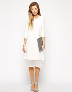 Winter white done right in this knit dress with a chiffon hem.