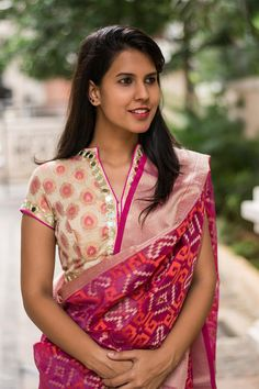 A festive brocade blouse in soft colors with sparkly mirrors galore! In a smart yet modest collared style with a cool vivid pink piping added to the mirror work detailing…this is one pretty blouse.   Do as we do and pair with a rich saree or any saree in pink tones. Or go for a striking contrast in silk.