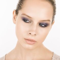 Holiday Party Eye Makeup | The Zoe Report - Purple Reign After priming the lid, apply a soft gray shadow from lash line to brow bone. Tightline the entire eye with a black waterproof pencil. Starting 3 quarters of the way in, blend a shimmery purple shadow up and into the crease of your lid and below the lower lash line extending past the outer corner to create a subtle wing. Finish with a lengthening mascara in black.