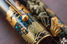 This Namiki maki-e fountain pen was created in 2017 in Japan by maki-e artisan Yumi Hayashi, who also has the distinction of being the first woman hired as a Maki-e artist by Namiki. It features the Togidashi-Taka Maki-e technique (burnished-raised maki-e), depicting frogs, leaves, and water designs. The pen has a fine 18kt gold nib (#20), fills via cartridge/converter (a CON-70 is included), and comes packaged in a wooden box with a bottle of ink.<br><br><i>Please allo...