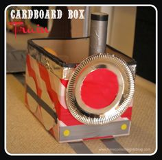 Cardboard box train and tunnel - turn your room into a train station. All you need is some duct tape, cardboard boxes and a big imagination. Great FUN for a rainy day.