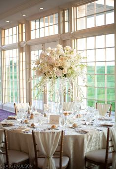 Lavish arrangement in shades of ivories and soft pinks  Floral Design by Crest Florist, East Hanover, NJ  Photography - Craig Paulson Photography  Venue - Trump National Golf Course, Bedminster, NJ