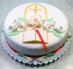 Beautiful Confirmation Cake featuring calla lilies and the Holy Bible.