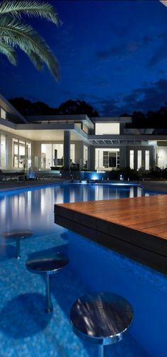 Pool with wet bar. Pinned to Pool Design by Darin Bradbury.
