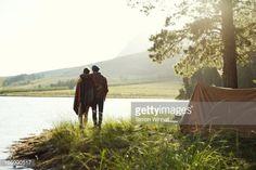 http://cache1.asset-cache.net/gc/166990517-young-couple-camping-by-lake-gettyimages.jpg?v=1&c=IWSAsset&k=2&d=mXftQW6Rx51rD0sViTWYLZdfLQ9oPYWeT9XB1JWiIB7blB5jh%2FpD3Q1nctsPx%2BsW