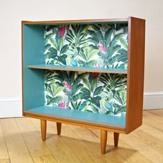 Unique Upcycled Mid Century Bookcase in Teal & Teak with Tropical Design by WhiteRabbitVintageGB on Etsy https://www.etsy.com/uk/listing/534772748/unique-upcycled-mid-century-bookcase-in