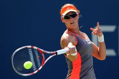 Samantha Stosur of Australia returns a shot against Varvara Lepchenko of the United States during their women's singles third round match on Day Five of the 2012 US Open