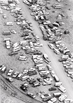 12/7/69, Altamont, CA — Aerial view of cars parked at random near Altamont Speedway where an estimated 300,000 rock music fans created a massive traffic tangle in a wide area surrounding the scene of a free rock concert. Police say several hundred cars remain in the area, apparently abandoned by their owners when they ran out of gas during the height of the influx to the concert. — Images by © Bettmann/Corbis