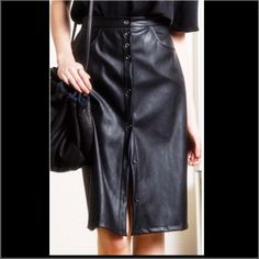 Streep Vegan Leather Skirt, NWT This skirt is chic, fashion-forward, and has a bit of stretch for extra comfort.  Stunning style with front buttons, hip pockets, and generous cut.  Gorgeous and ready to be yours!  Machine washable for easy care.   Photos courtesy of Loup. HOST PICK 2/6! 💃💃💃💃 Loup Skirts Pencil