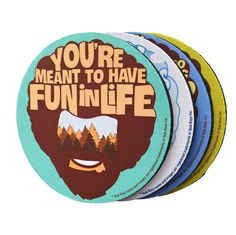 The Bob Ross - Happy Little Coasters is a set of 4 rubber coasters inspired by…