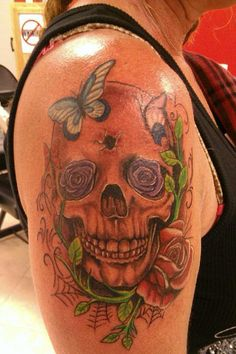 Skull Flowers tattoo by Micah