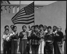 Students at Raphael Weill Public School, Geary & Buchanan Streets, San Francisco, say Pledge of Allegiance, 20 April 1942; students pictured of Japanese ancestry would soon be sent to War Relocation Authority camps (Photo: Dorothea Lange. US National Archives: 210-G-C122)