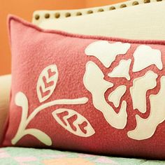 Turn a blanket into an elegant pillow with applique. Use their free pattern to make this beautiful floral applique and give this pillow an instant vintage feel.