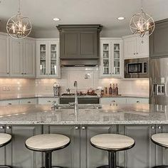 I love how the range hood & island are darker than the other cabinets. Moon White Granite Countertops, Transitional, Kitchen, Benjamin Moore Kendall Charcoal, Gonyea Homes Moon White Granite, White Granite Kitchen, White Granite Countertops, Granite Backsplash, Herringbone Backsplash, Backsplash Ideas, Kitchen Backsplash, Kitchen Countertops, Small Condo Kitchen