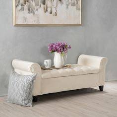 Accent your bedroom or living room decor with this lavish ottoman bench by Christopher Knight Home. Swirling crossed legs in a rich espresso offer a striking color contrast to the upholstered bench to