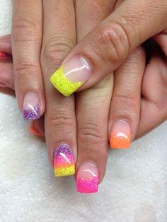 Yellow, pink, purple, and orange gel nails.