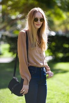circular frames + sheer blouse + jeans : tucked in