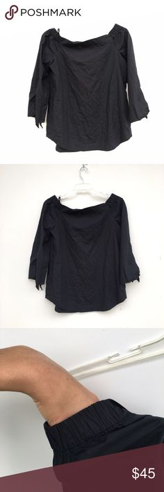 Free People NWOT Dark Navy Off the Shoulder Blouse Brand new without tags Top by Free People. Very dark navy color. Has a small tied bow at the end of each sleeve. Shoulder area has scrunching so it can be pushed off the shoulders. Free People Tops Blouses