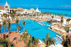 Swimming Pool with Swim-Up Bar - Hotel Riu Palace Riviera Maya, #Riviera Maya, #Mexico. www.lydiastravelerservices.com