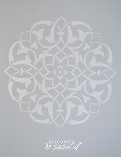 The room is a pale gray and an even paler gray for the stencil.  The stencil is from Royal Design Studio.  It is the Marrakech Medallion Stencil.