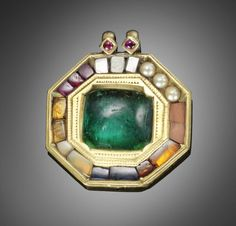 An important gem-set gold Navratna Pendant from the Treasury of Tipu Sultan, The Tiger of Mysore (1750-99), Mysore (Seringapatam), late 18th Century  octagonal, set with a large central cushion flat back cabochon Columbian emerald, within a border of topaz, blue sapphire, zircon, cat's eye, ruby, coral, diamond and pearl