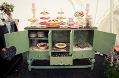 Great display for later in the bar... Put leftover cakes from afternoon tea there for evening munchies on an old dresser with plates in drawers and 'help yourself' sign. Emily and Matthew's 'Vintage Meets Rock n Roll' Welly Wearing Wedding by Kari Bellamy - Boho Weddings™