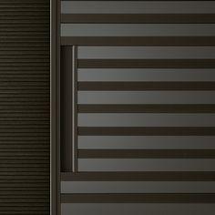 Stripe Rimadesio - cabina armadio www.spaziomateriae.com La maniglia, integrata nel disegno dei traversi, è un dettaglio esclusivo che sottolinea la continua ricerca estetica Rimadesio nell'ambito delle porte scorrevoli per interni