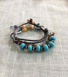 Turquoise, Amber, Red Coral, Yellow Jade, Amethyst, Silver, Pewter, Copper button closure, and silver infinity connectors make up this version of our Traveler's line in a wrap bracelet.