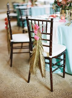 floral arrangements for the back of your reception chairs #chair #reception #floral http://www.weddingchicks.com/2013/12/27/stately-southern-wedding/