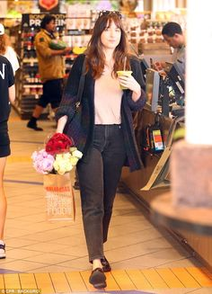 Flower power: The actress was seen carrying a bundle of bouquets