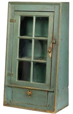 Northeast Auctions, 8/19/17 Lot # 500. Est. $2,500-$4,000. Realized: $14,400 ($12,000 hammer). RARE NEW ENGLAND FEDERAL BLUE-PAINTED PINE CANT-BACK HANGING CUPBOARD. The paned door opening to a shelved interior fitted for spoons, and above a single drawer. Height 40 inches, width 22 ⅝ inches. Provenance: Tananbaum Collection.