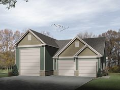 Two-car garage with RV garage is adorned with multiple gables