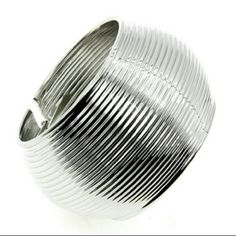 NWOT Beautiful Silver Plated Alloy Bracelet Silver plated alloy bracelet a stunner for sure. Jewelry Bracelets